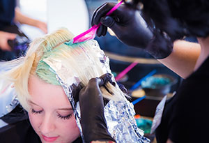 Woman Getting Hair Colored at Salon